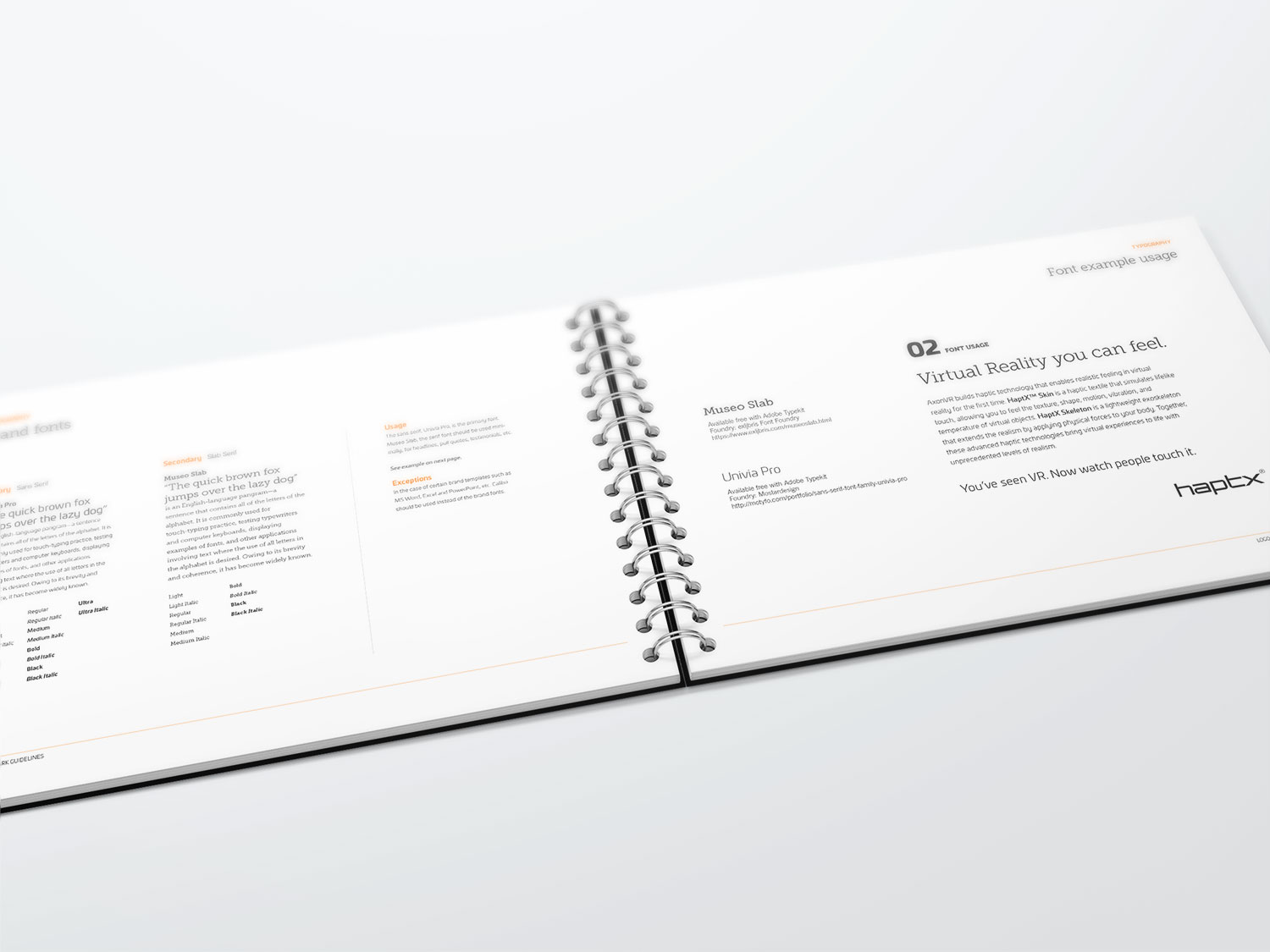 A HaptX book that has been opened and laid out on a white table